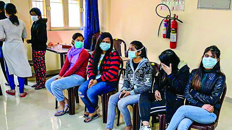 Indian nationals who were airlifted from coronavirus-hit Hubei province of China's Wuhan at the ITBPs quarantine facility at Chhawla in New Delhi, Sunday. (Photo: PTI)