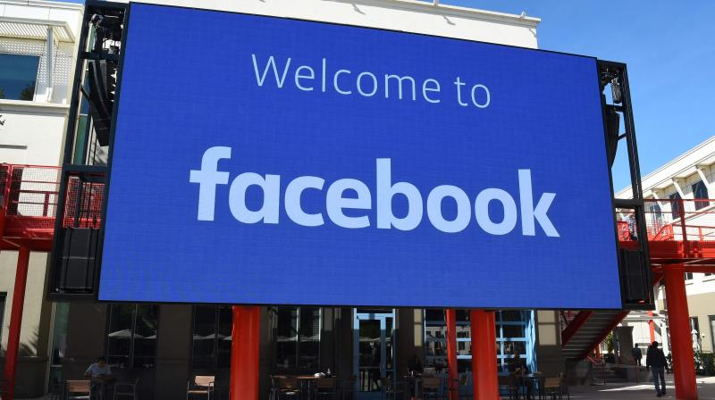 This file photo taken on October 23, 2019 shows a giant digital sign at Facebook's corporate headquarters campus in Menlo Park, California. - Facebook said on February 23, 2021 it will lift a contentious ban on Australian news pages