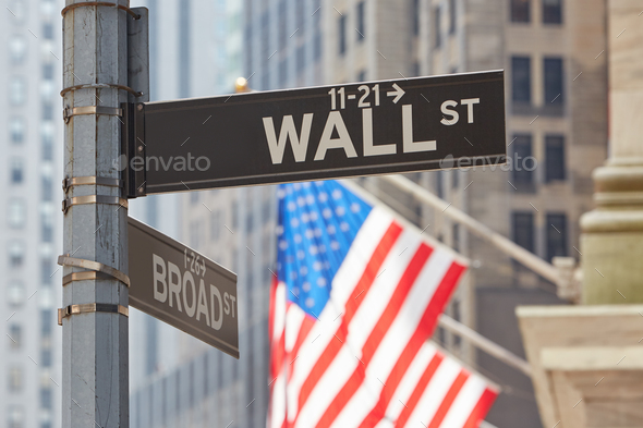 Wall Street sign near Stock Exchange with US flags, New York Stock Photo by  andreahast