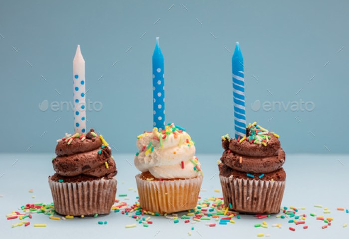 Birthday Cupcakes With Candles On Blue Pastel Background Copy Space