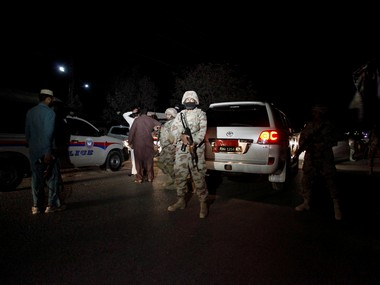 A Pakistani soldier stands guard outside the Police Training Center after an attack on the center in Quetta. Reuters
