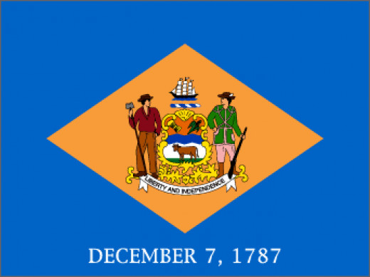 ". Below the  diamond are the words ""December 7, 1787,""  indicating the day on which Delaware was the  first state to ratify the United States constitution"