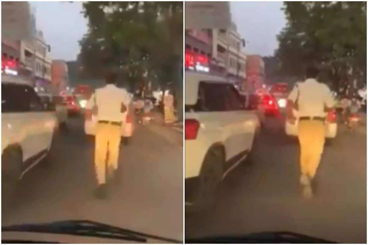 Watch: Hyderabad Traffic Cop Runs 2 Km to Clear Traffic Jam For an Ambulance, Hailed on Social Media | India.com