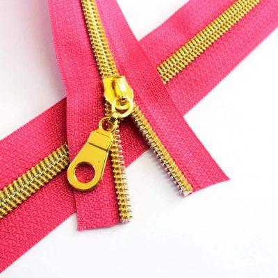 5-Nylon-Coil-Zipper-fuchsia-with-gold-teeth