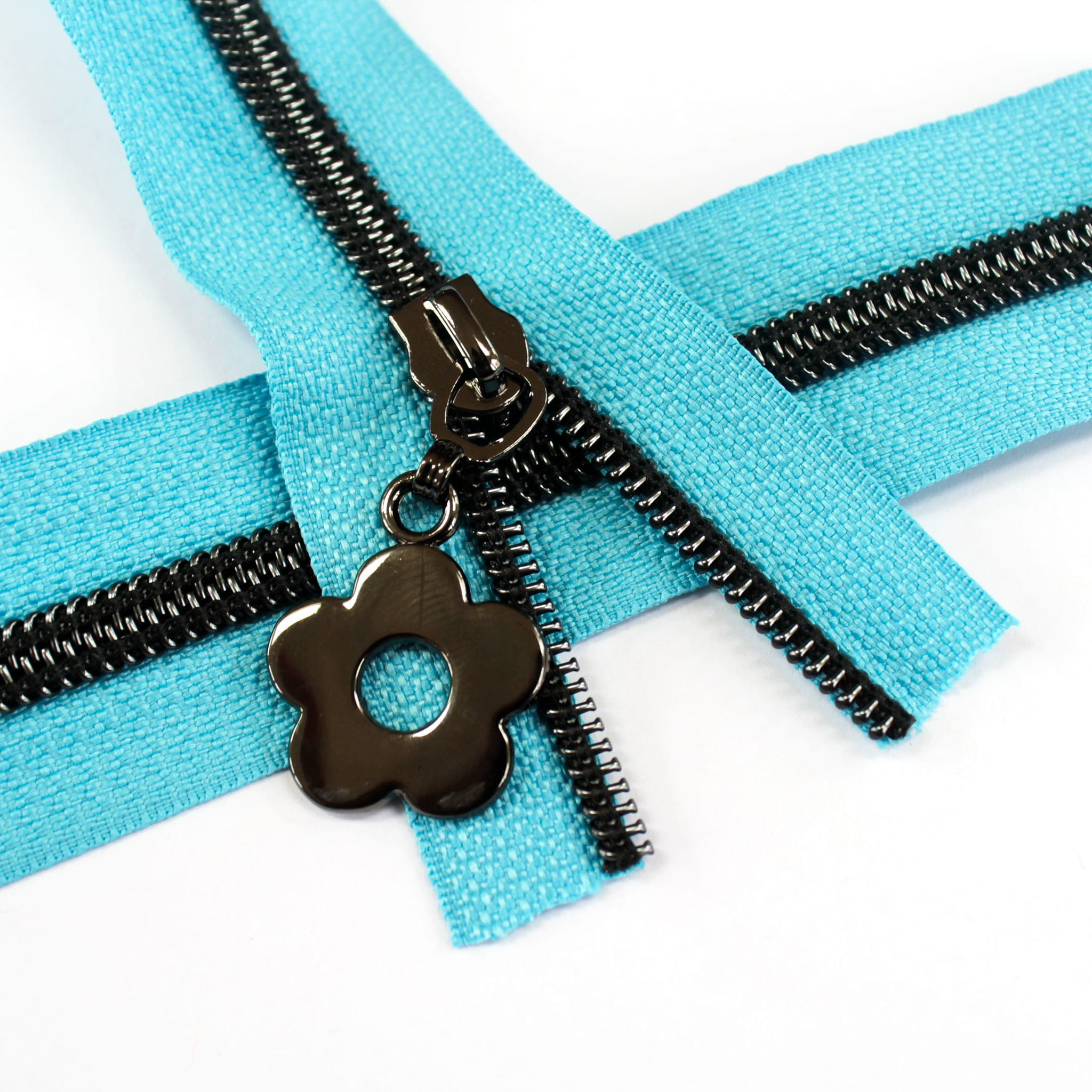 #5-Nylon-Coil-Zipper-turquoise-with-gunmetal-teeth-flower-pulls