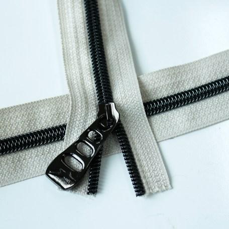 beige zipper with gunmetal coil