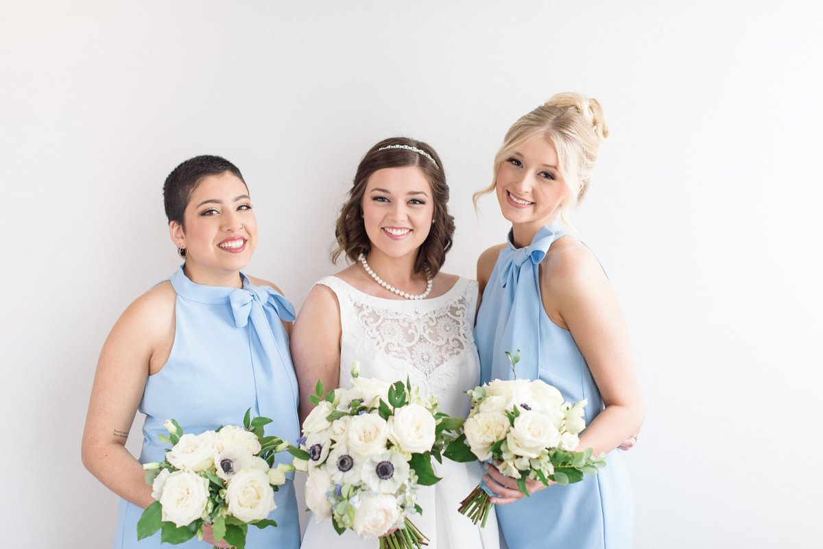 light blue bridesmaids dresses with white flowers
