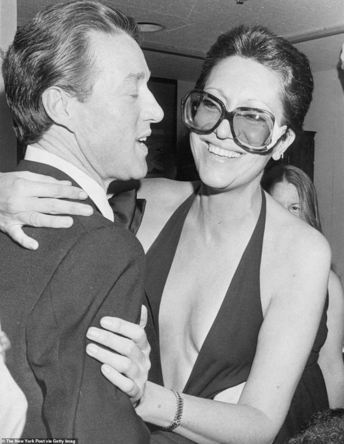 Elsa Peretti, who went from Halston model and Studio 54 regular in the 1960s and 70s to one of the world's most famous jewelry designers with timeless Tiffany & Co. collections, has died aged 80. She is pictured above with Halston in March 1977