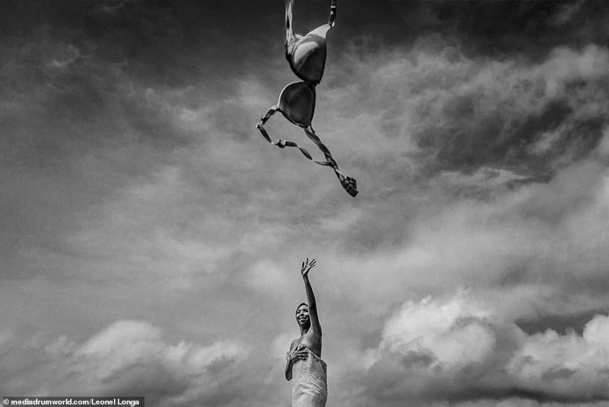 Wave your bra in the air like you just don't care! The Fotografos de Boda Wedding Photography Award has revealed its winning images from the past year, including this snap of a bride in Venezuela flinging her lingerie into the air while holding her dress