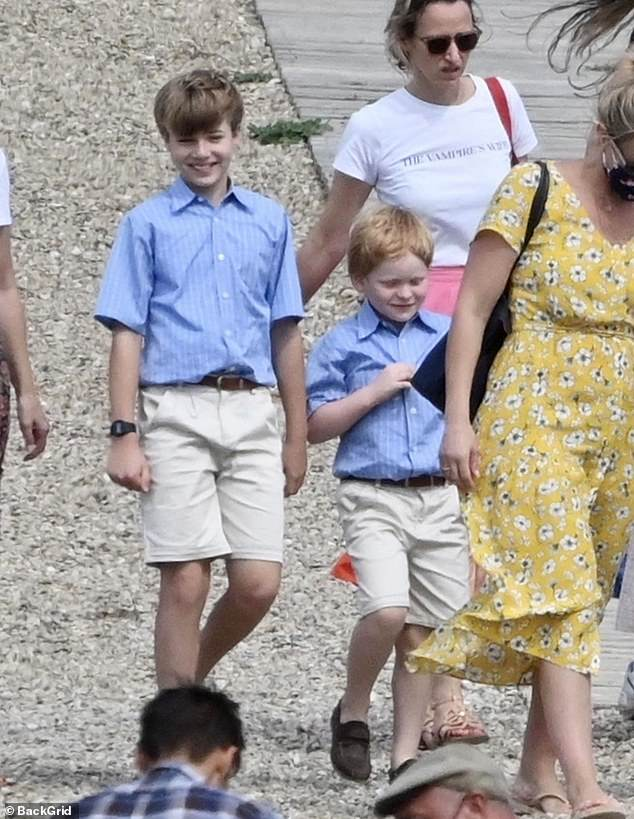 Cute:The Crown's child actors Timothee Sambor (left) and Teddy Hawley got into character as the young Princes William and Harry to film scenes for series five in Spain on Thursday