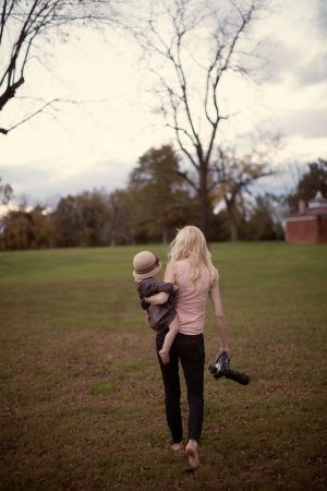 Sarah Wilkerson with camera and child