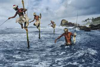 """CAPTION©Masters of Photogra©Masters of Photography: Fishermen at Weligama. Sri Lanka, 1995.MAX PRINT SIZE: 60X80SRILANKA-10006IG: I took this image of men fishing in Weligama off the South coast of Sri Lanka.10/06/2016IG OLD: This is one of the images currently featured in my exhibition at Patricia Conde Galería (@patriciacondegaleria) in Mexico. The exhibition runs until September 3rd, I hope you can visit if you're in the area.I took this image of men fishing in Weligama off the South coast of Sri Lanka.08/13/2015""""Fishermen along the southern coast of Sri Lanka cast their lines in the traditional way atop poles so they can work in shallow water without disturbing the fish."""" - George Eastman HouseLike outlandish herons, a flock of men clad in traditional saram fish the south coast from wooden perchs. Not long ago their island nation was poised to join Asia's economic dragons, but 13 years of strife have cramped development and kept many Sri Lankans working the land and sea like their ancestors. Vol. 191 No. 101/1997 National Geographic Magazine. Vol. 191, No. 1, pgs. 110-111, January 1997, Sri Lanka: A Continuing Ethnic War Tarnishes the Pearl of the Indian Ocean.NN11429210, MCS1995006K10006book_Iconicfinal print_MACROfinal print_Sao Paulo final print_Birminghamfinal print_HERMITAGEfinal print_Zurichfinal print_Ankarafinal print_UticaFine Art Printretouched_Sonny Fabbri 3/4/2015"""