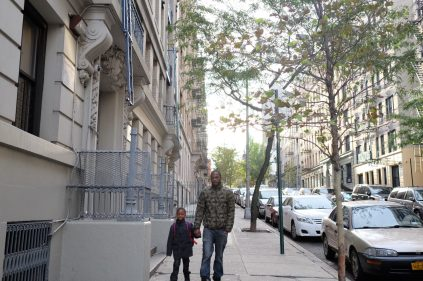 Bronx, NY Oct. 12, 2014 Every morning Travis walks his son 10 blocks to his school. Photo by M.B. Elian