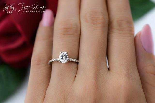 34 Carat Oval Cut Accented Solitaire Wedding Ring Half