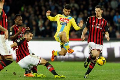 AC Milan's Essien, Rami and De Sciglio challenge Napoli's Insigne during their Italian Serie A soccer match in Naples