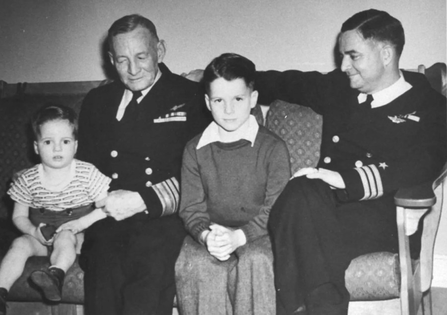 John McCain (center) sits as a young boy with his grandfather Vice Adm.