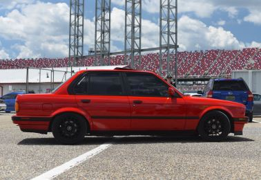 E30 sedan red