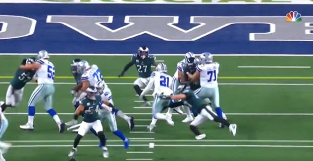 Ezekiel Elliott plows over Malcolm Jenkins