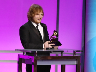 """Ed Sheeran accepts the award for best pop solo performance for """"Thinking Out Loud"""" at the 58th annual Grammy Awards. AP"""