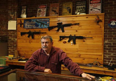 A man works in his gun shop in Maine