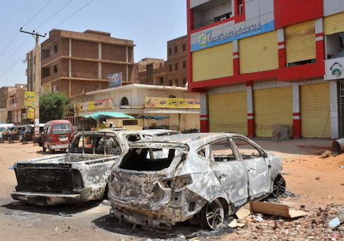 A picture taken in 2013 shows burnt vehicles in a street of the Sudanese capital Khartoum