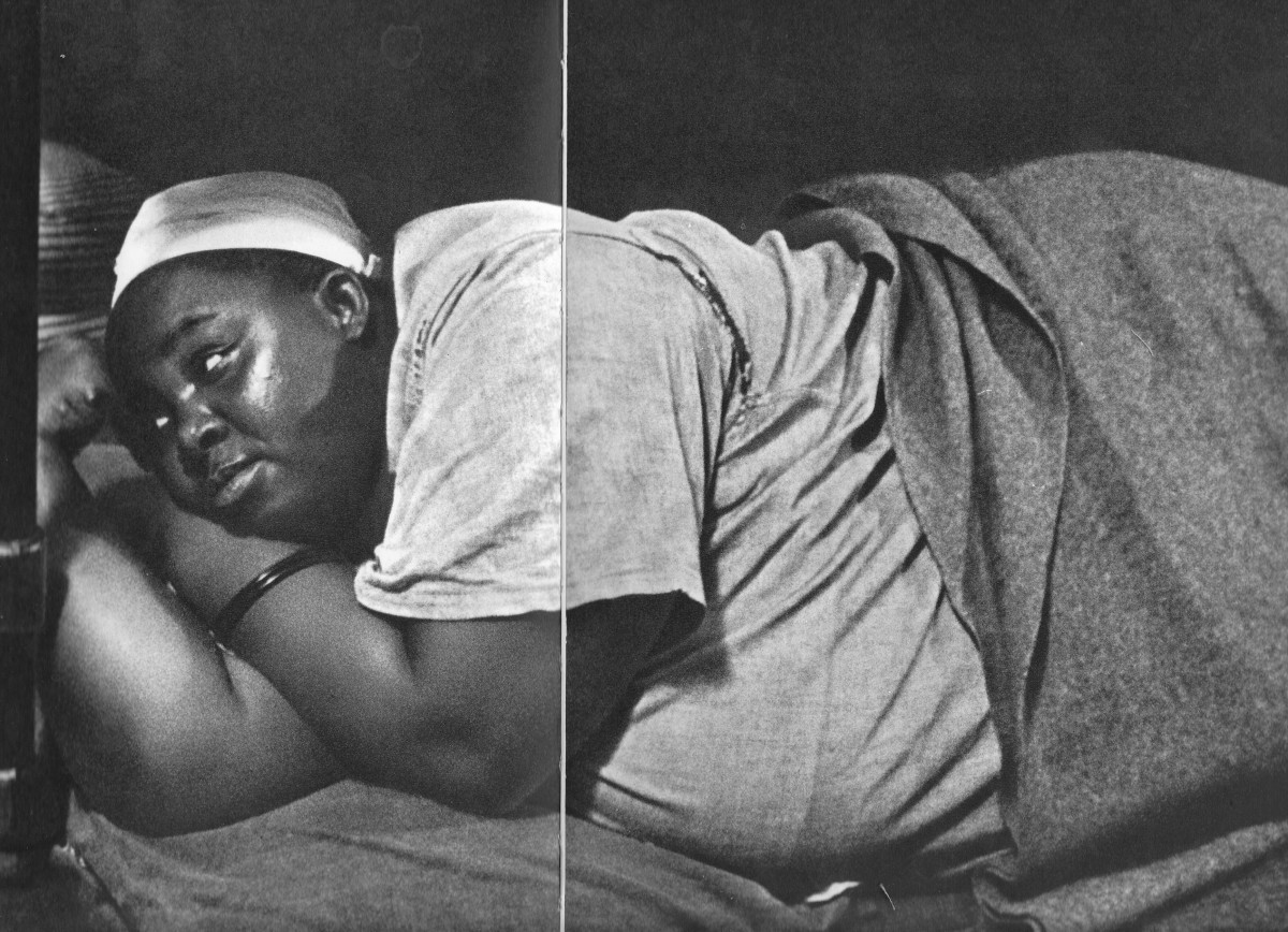 Maternity Ward in South AFrica and due to a shortage of beds, a pregnant woman about to give birth lying on the floor. Botha was right, they were not paying people to bring Black children into the world.