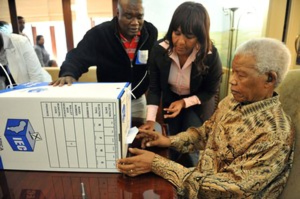Mandela casting his vote at home assisted by his grand daughter, Ndleka Mandela, and the IEC President Officer Mr. Mshali,in his home in Houghton, Johannesburg.