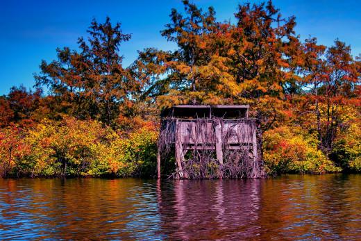 A duck blind alongside Louisiana waters.