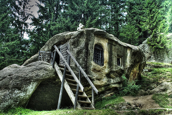 Hidden in plain sight: tiny boulder house/ survival shelter looks like a natural boulder that can be concealed by vines and fast growing plants such as bananas