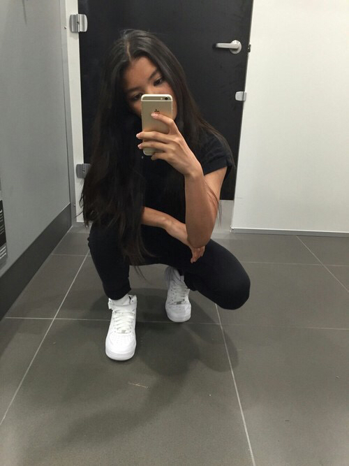 A Person Wearing Nike Shoes
