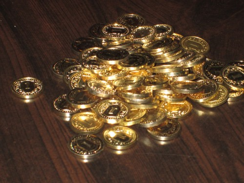 A pile of coin tokens! No, Guilds doesn't come with this many. But when you add together the tokens from Guilds, Seaside, and Prosperity, you realize you're almost ready for your own Money Bin.