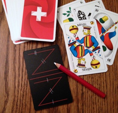 """The best partnership games are of the """"marriage group,"""" so-called because pairing Kings-Queens of the same suit score points (Pinochle is the most common American version). Here a Jass board is used to keep score in Jass - the national card game of Switzerland, but with dozens of variations throughout the world."""