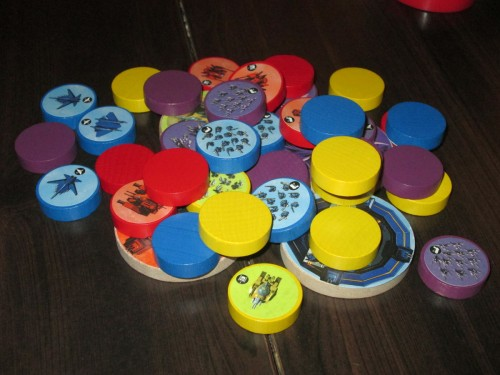 These are the discs in Flick Wars. They are clearly colored and stickered, easy to identify. The disc icons match the faction cards, which list each unit's abilities.
