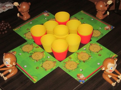 Coconuts set up for four players. Or monkeys.