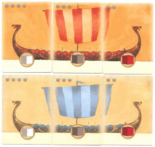Longship cards in the first edition where the same for everyone (top). The second  edition gives each captain her own color.