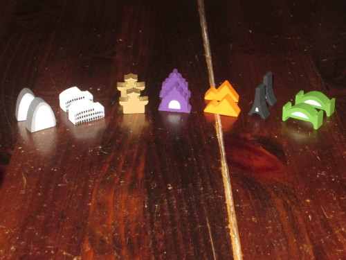 The city tokens. The custom shapes are above and beyond, although the Taj Mahal (purple) is a little baffling to my eye.