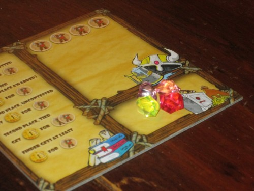 Some of the colors of gems in Dwarves Inc. look very similar on the player mats, especially from across the table.
