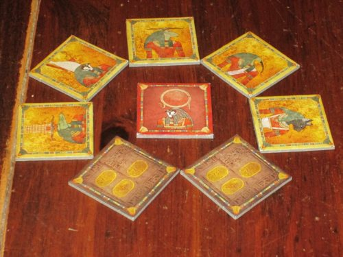 God tiles, with Ra in the center. Ra tiles can be good or bad, depending on where you are in the epoch and what you want to happen. Regardless, they always mark an auction and that time is marching on.
