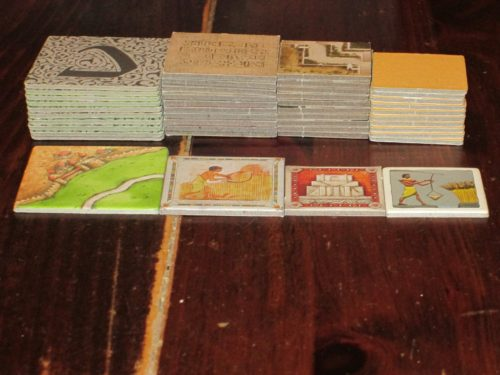Here's a comparison of how Ra tiles stack up (!) next to other games. Included (left to right) are Carcassonne, Ra (new edition), Tigris & Euphrates (new edition), and Ra (old edition).