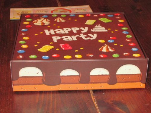 The box doubles as the playing area and is designed to look like a cake. This is a nice touch.
