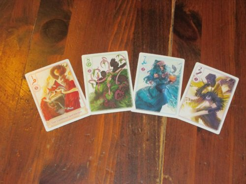 The four suits in Hocus. They are the same except that each owl card has a special ability.