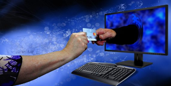 credit card being given through the computer screen
