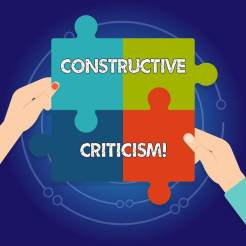 Jigsaw puzzle showing the words constructive criticism - fear of criticism