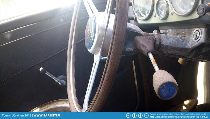 Wood steering wheel and a period shifter knob.