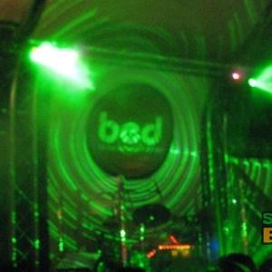 BED's logo basked in laser light