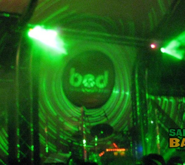 BED's logo basked in laser light