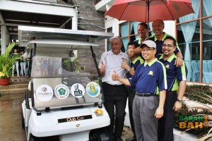 Representatives from the companies involves with the prototype solar panel mounted golf buggy.