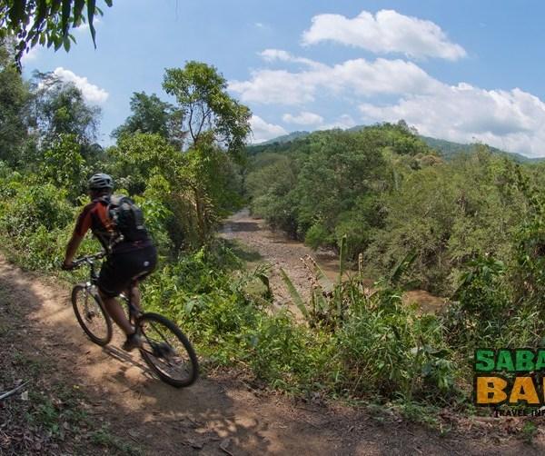 Cycling through Tuaran on a 1-day Mountain Biking Tour in Sabah, Borneo. Photo by Bike Borneo.