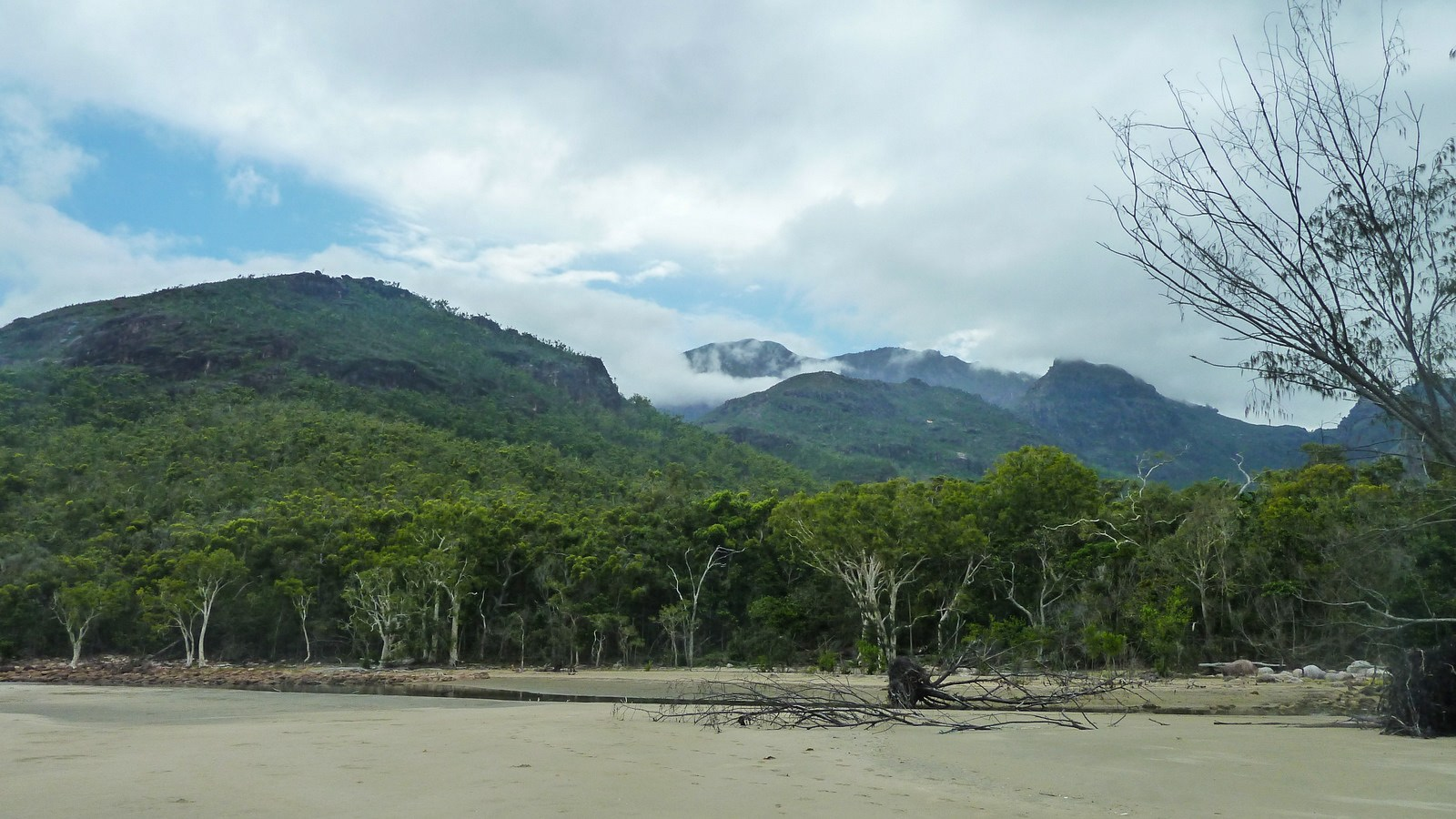 this is a photo of the mountains covered in clouds during a hike on hinchinbrook island