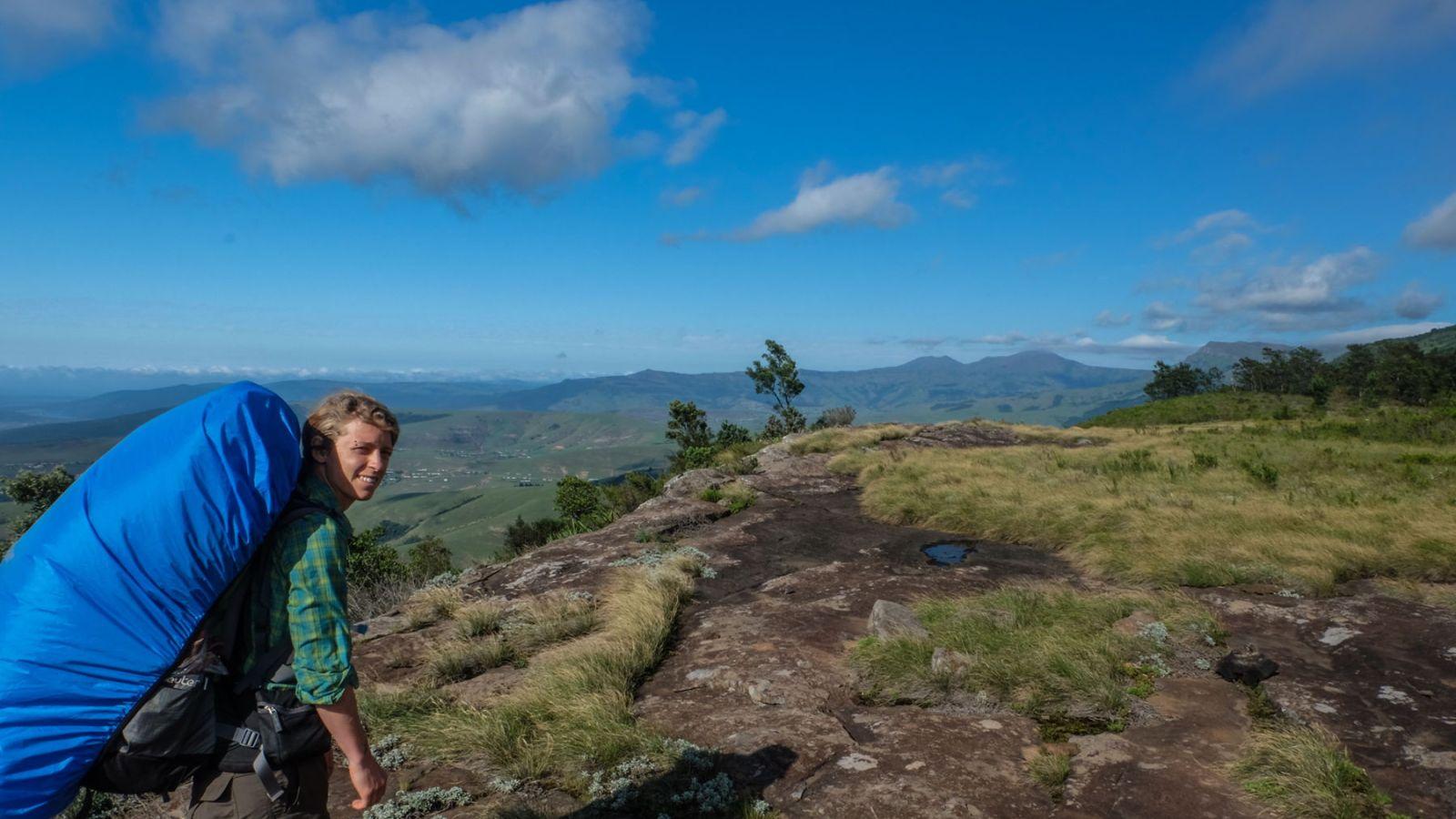 a photo of a hiker on a mountain on the amathole trail.